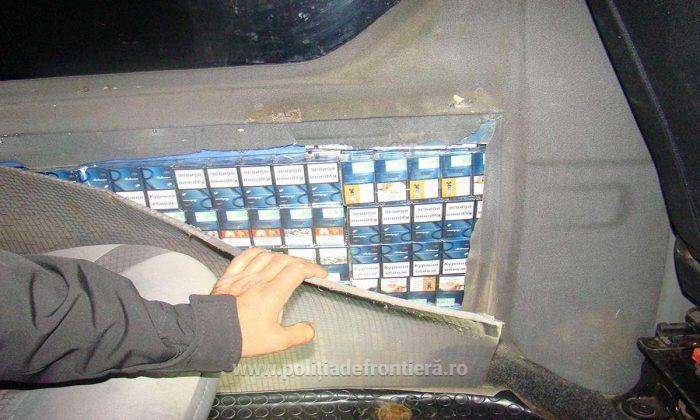 5.000 lei amendă și interdicție de intrare în România pentru un ucrainean care a ascuns în peretele microbuzului 450 pachete cu țigări